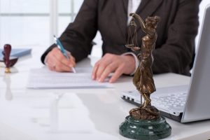 Lawyer-signing-contracts 2